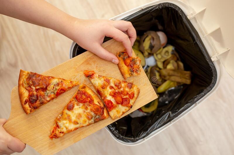 woman-hands-throwing-food-trash-bin-waste-food-food-concept-woman-hands-throwing-food-trash-bin-waste-food-176153390